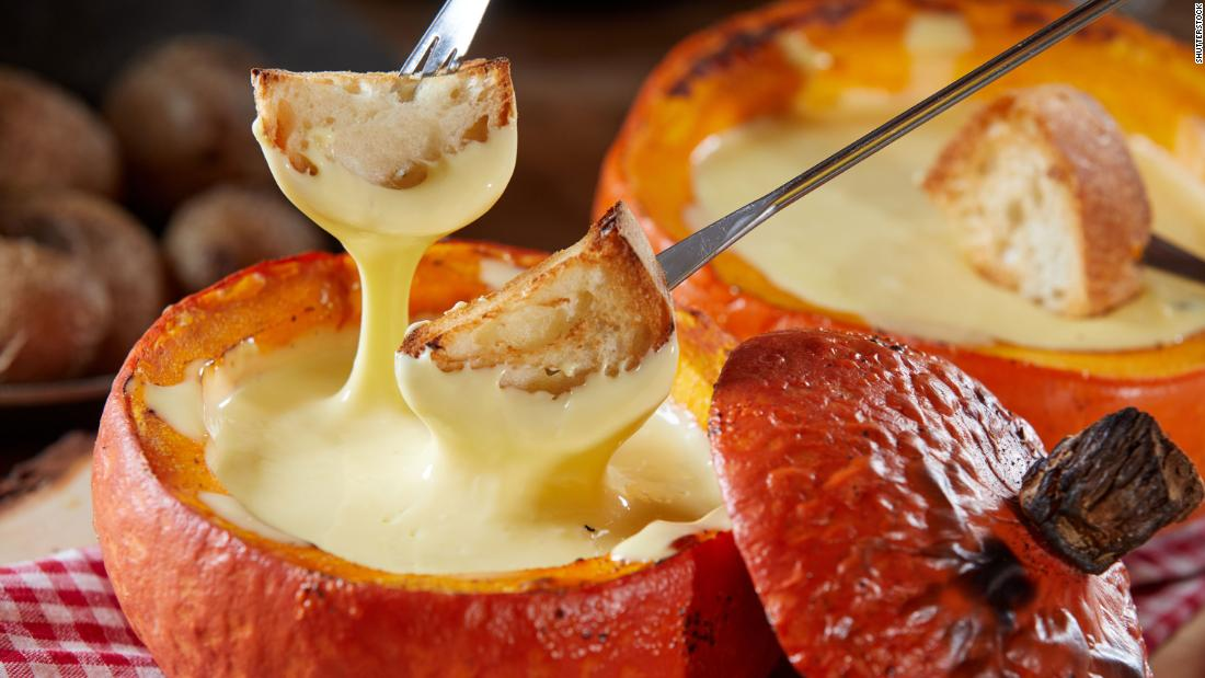 """Hollow out smaller gourds and fill with <a href=""""https://www.foodandwine.com/recipes/classic-swiss-cheese-fondue"""" target=""""_blank"""">cheese fondue</a> for individual treats for every family member."""