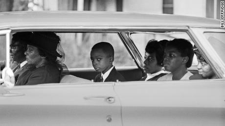 Ben Chaney, center, in the car on the way to his brother's funeral, August 1964, Mississippi (Bill Eppridge).