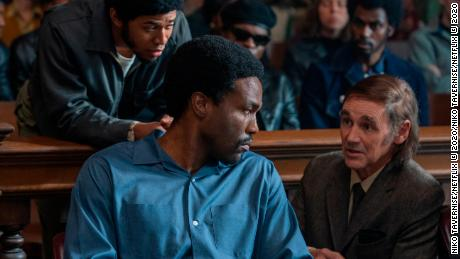 Kelvin Harrison Jr. (standing), Yahya Abdul-Mateen II and Mark Rylance in 'The Trial of the Chicago 7' (Niko Tavernise/Netflix).