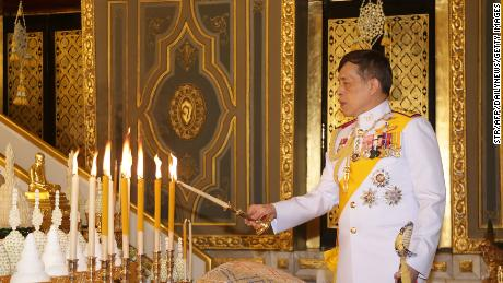 Thailand's King Maha Vajiralongkorn lights candles as he takes part in a Buddhist ceremony to mark the 2020 Kathina festival at Wat Ratchabophit in Bangkok on October 10, 2020.