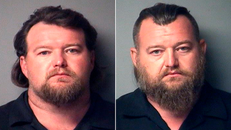 Michael Null, left, and William Null are shown in booking photos provided by the Antrim County Sheriff.