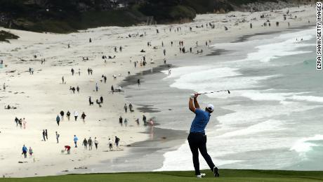 Rahm plays a second shot on the ninth hole during the third round of the 2019 US Open at Pebble Beach.