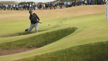 Rahm plays out of a bunker during the second round of The Open in Carnoustie, Scotland.