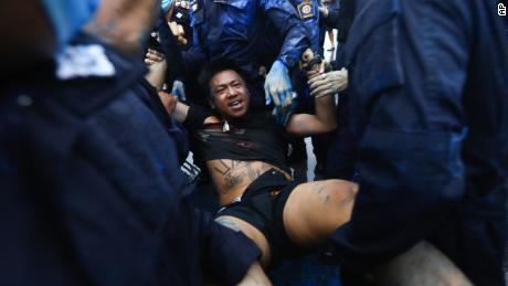 Police arrest activist Jatupat Boonpattararaksa near in Bangkok, on Tuesday.