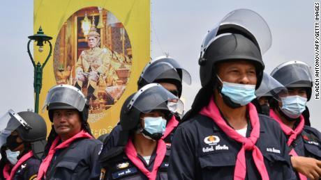 A portrait of Thailand's King Maha Vajiralongkorn is seen as police monitor an anti-government rally by pro-democracy protesters in Bangkok on October 14.