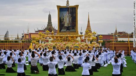 Students pay their respects before the portrait of the late Thai King Bhumibol Adulyadej during a ceremony marking the fourth anniversary of his death, on October 13.