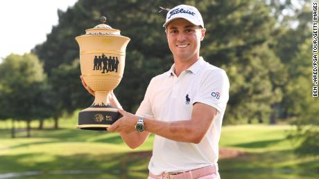 Thomas holds the trophy after winning the World Golf Championships-FedEx St. Jude Invitational.