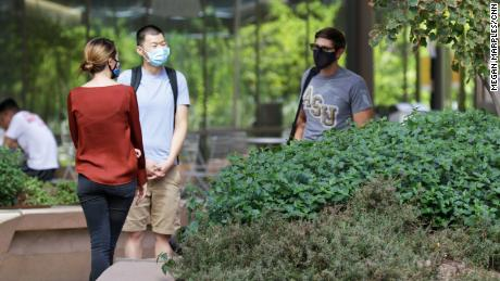 Students are required to wear masks on campus, even outside buildings.
