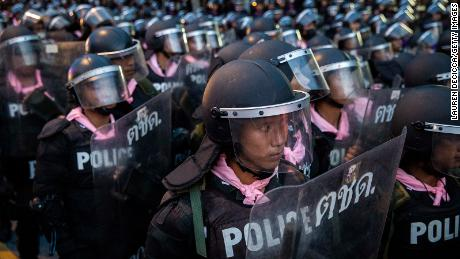 Thai riot police force protesters to retreat away from Government House on October 15, 2020 in Bangkok, Thailand.