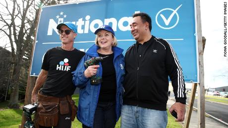 New National Party leader Judith Collins with her husband David Wong-Tung, right, and her tennis coach and sign builder, David Knott, on July 18, 2020, in Auckland, New Zealand.