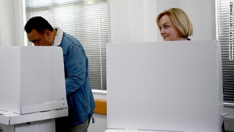 National Party leader Judith Collins and husband David Wong-Tung vote on October 4, 2020, in Auckland, New Zealand.