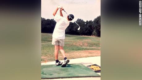 Rahm pracitices on a golf range.