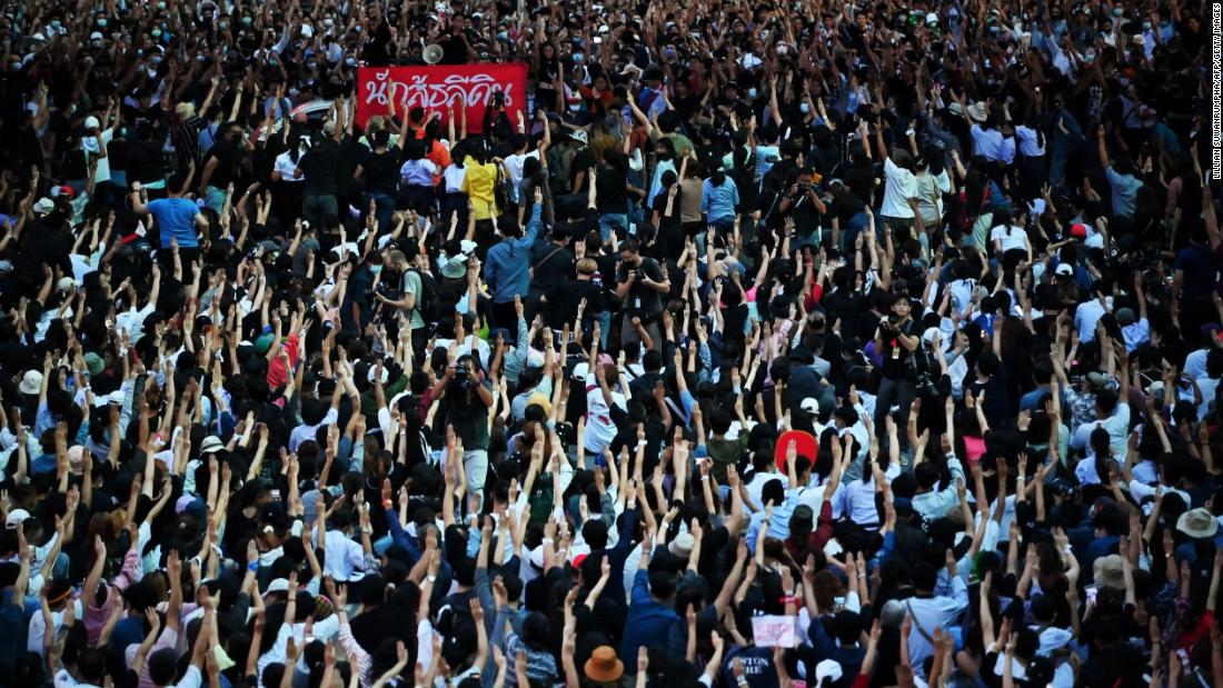 Protesters hold up the three-finger salute en masse on October 15.
