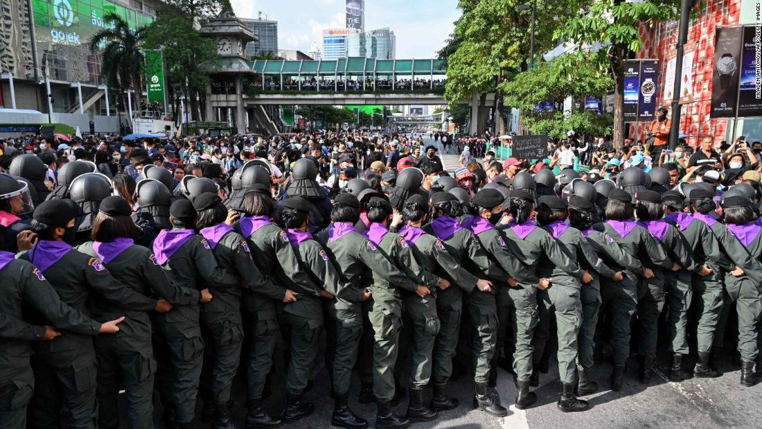 Police line up in front of pro-democracy protesters gathering for a rally on October 15.