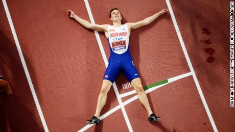 Warholm catches his breath after winning gold at the World Athletics Championships in Doha.