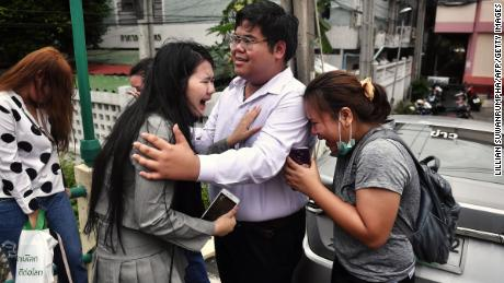 "Pro-democracy activist Bunkueanun ""Francis"" Paothong comforts loved ones before he enters the Dusit police station to answer charges of harming Thailand's Queen Suthida on October 16, 2020.   Two Thai protesters could face life imprisonment for violence against the Queen 201016035741 01 bunkueanun paothong 1016 large 169  Two Thai protesters could face life imprisonment for violence against the Queen 201016035741 01 bunkueanun paothong 1016 large 169"