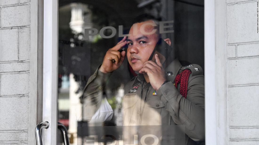 A policeman looks on from his booth in Bangkok on October 15.