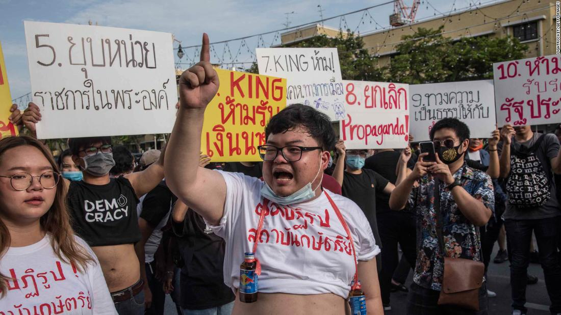 "Parit ""Penguin"" Chiwarak, 22, a student and one of the leaders of the pro-democracy movement, is allowed by police to read a 10-point manifesto on reforming the monarchy."