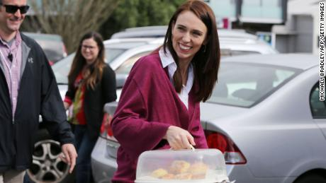 Labour Leader Jacinda Ardern arrives with scones as she visits Labour Election Day volunteers in Auckland on October 17, 2020.   New Zealand election: Jacinda Ardern wins second term as Prime Minister in landslide victory 201016222723 04 new zealand election 1017 large 169  New Zealand election: Jacinda Ardern wins second term as Prime Minister in landslide victory 201016222723 04 new zealand election 1017 large 169