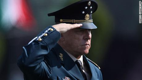 Mexico's Defense Secretary Gen. Salvador Cienfuegos Zepeda salutes soldiers at the Number 1 military camp in Mexico City.