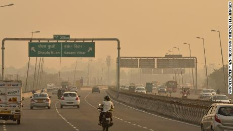 Traffic on a road in New Delhi on October 18, as the city reports high levels of air pollution.