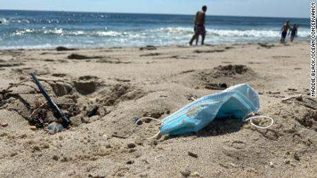PPE waste, including disposable masks, found on a beach in New Jersey.