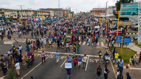 Protesters throng the streets during a demonstration against police brutality in Ikeja, Lagos, on October 19, 2020.