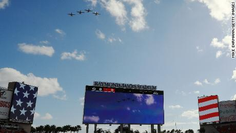 Airplanes fly over Raymond James Stadium before the start of the game between the Tampa Bay Buccaneers and the Green Bay Packers on Sunday.