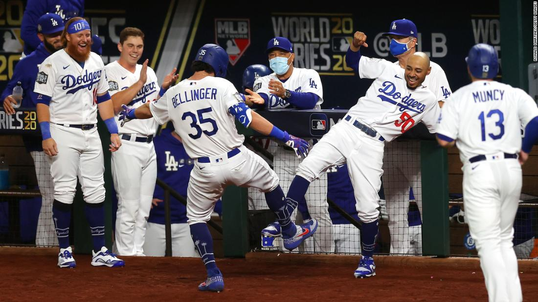 Cody Bellinger and Mookie Betts celebrate after Bellinger's fourth inning home run.