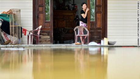 A woman looks out from her flooded house in Quang Dien district in central Vietnam's Hue province on October 15, 2020.