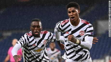 Rashford (R) celebrates after scoring a goal during in the Champions League on Tuesday.