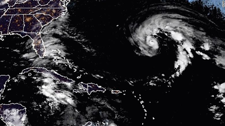 Epsilon has strengthened to a hurricane and is moving toward Bermuda
