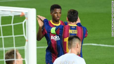 Ansu Fati celebrates with Lionel Messi after scoring a goal against Ferencvarosi.