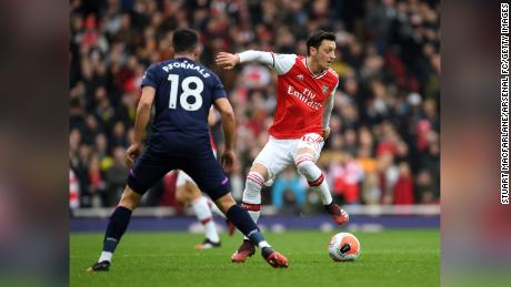 Ozil takes on Pablo Fornals of West Ham during a Premier League match on March 7, 2020.