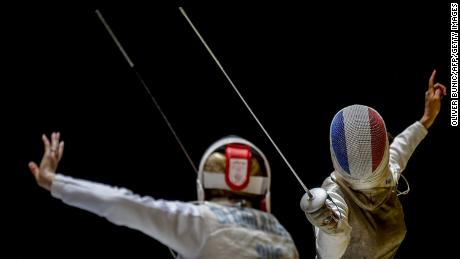 Ysaora (R) vies with Russia's Deriglazova Inna during the women's semifinal of foil competition at the European Fencing Championships in Novi Sad in June 20, 2018.