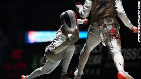 Eva Hampel of Germany (R) competes against Thibus of France during the women's foil team competition at the 2018 World Fencing Championships in Wuxi in China's eastern Jiangsu province in July 2018.