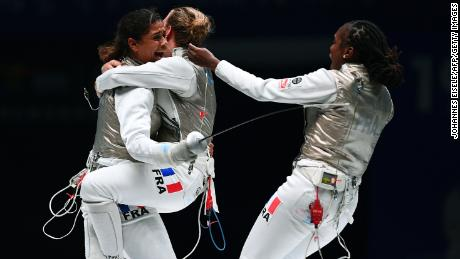 Thibus (L) of France celebrates with his team after winning against Jeon Her Sook of South Korea after the women's foil team competition final at the 2018 World Fencing Championships in Wuxi in China's eastern Jiangsu province in July 2018.