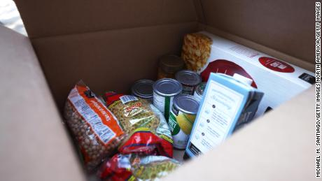 Dry and can foods inside a box during a food giveaway in New York City in early October.
