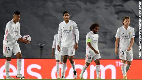 Real Madrid's players look bewildered as Shakhtar scores its third goal.