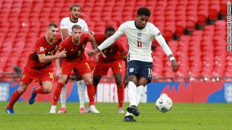 Rashford scores a penalty against  Belgium at Wembley Stadium.