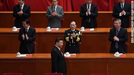Chinese President Xi Jinping is applauded as he arrives for a ceremony marking the 70th anniversary of China's entry into the Korean War, in Beijing's Great Hall of the People on October 23.