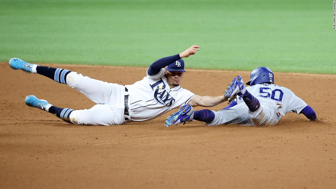 The Dodgers' Mookie Betts  steals second base against Willy Adames during the sixth inning of Game 3.