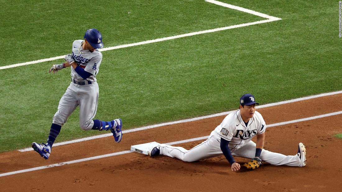 The Rays' Choi stretches to make the putout against Mookie Betts during Game 3's first inning.