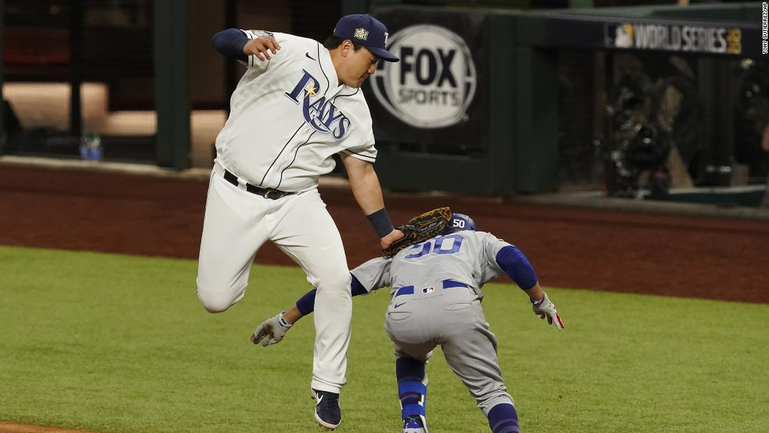 The Dodgers beat the Rays 6-2 게임 내 3 금요일에, 십월 23, taking a 2-1 series lead. 여기, Rays' first baseman Ji-Man Choi tags out Mookie Betts at first base during the eighth inning.