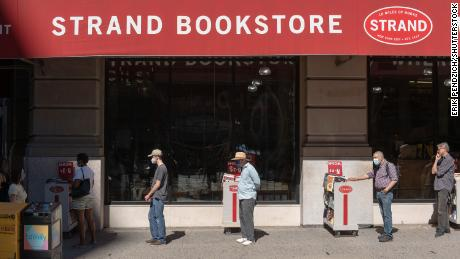 Customers socially distance as they wait to enter Strand Book Store in Union Square in New York in September.