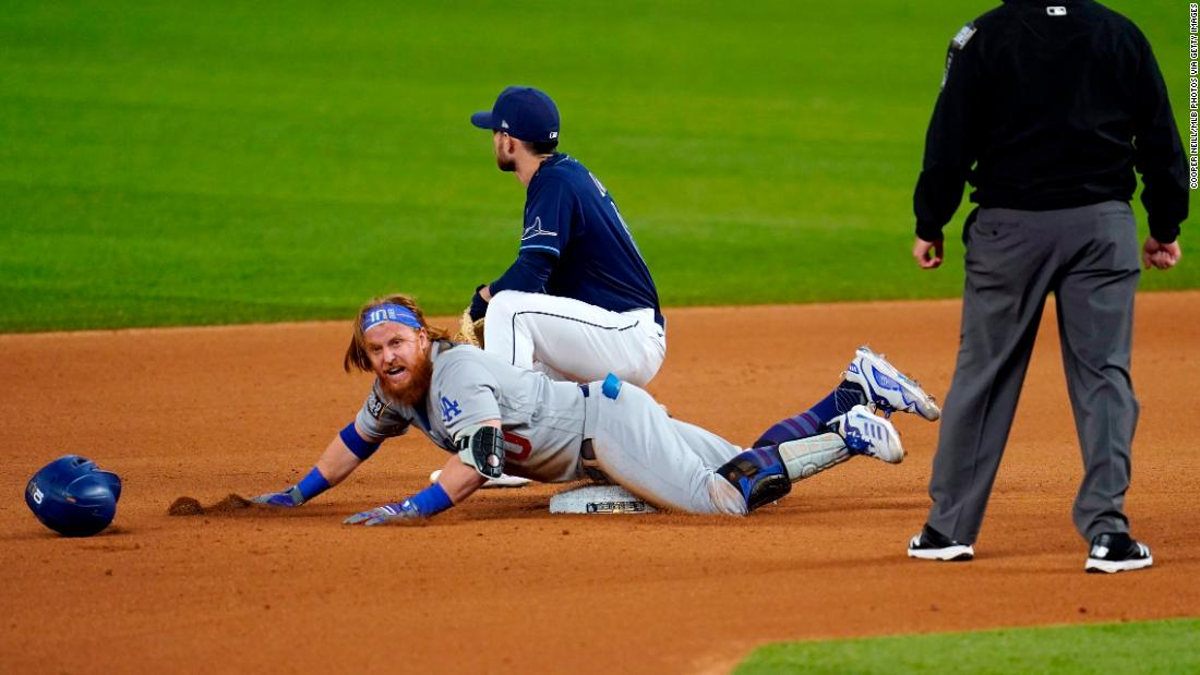 The Dodgers' Justin Turner slides into second base with a double in the seventh inning during Game 4.