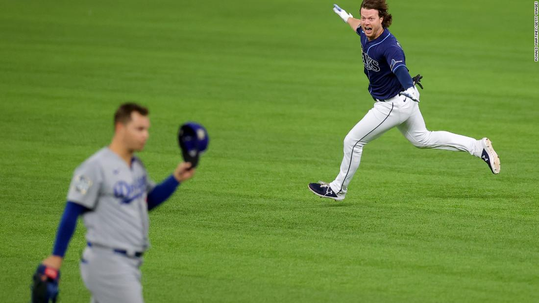 The Rays' Brett Phillips celebrates after hitting a two-run walk-off single to beat the Dodgers 8-7 게임 내 4 at Globe Life Field in Arlington, 텍사스, 토요일에, 십월 24.
