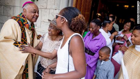 Washington DC Archbishop Wilton Gregory, left, greets parishioners following Mass at St. Augustine Church in Washington on June 2, 2019.