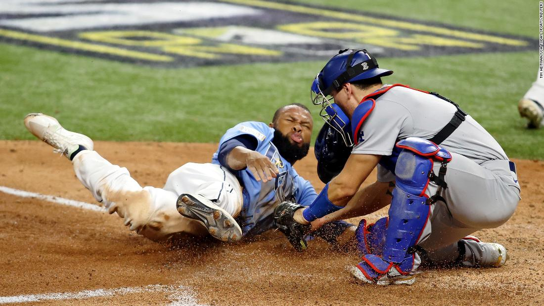 Dodgers catcher Austin Barnes tags out Rays left fielder Manuel Margot trying to steal home during the fourth inning.