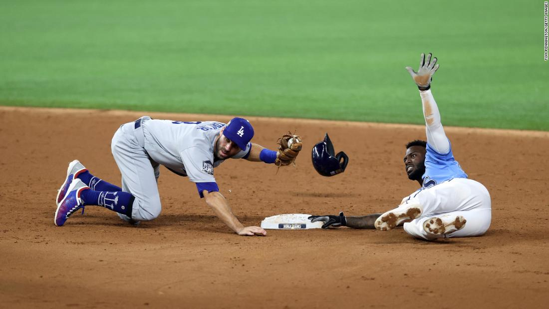 Chris Taylor of the Dodgers successfully tags out the Rays' Randy Arozarena as he attempted to steal second base during the third inning.